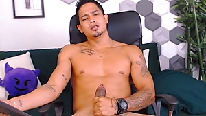 Handsome Latino Spitting On His Cock